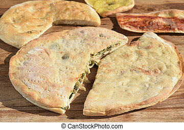 stuffed pizza with escarole and pine nut