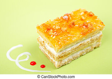 Delicious cake with soft shadow on green dish Shallow DOF
