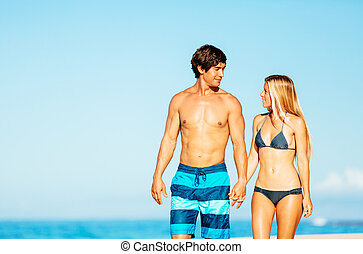 Attractive Couple Walking on Tropical Beach - Happy...