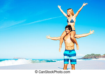 Atractive Couple Having Fun on the Beach - Happy Attractive...