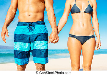 Beach Couple - Attractive Fit Couple on the Beach in...