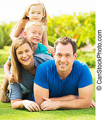 Happy Family Outside - Portrait of Happy Family of Four...