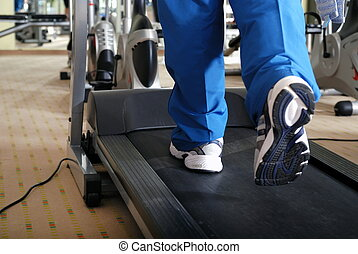 running on a treadmill - Man running on treadmill in gym