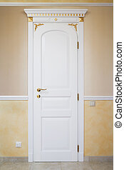 White door with an ornament in a modern apartment