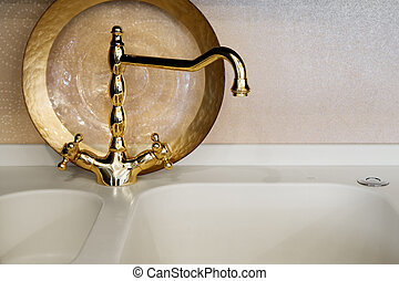 faucet of gold color - The beautiful water faucet of gold...