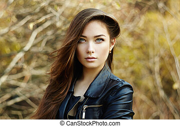 Portrait of young beautiful woman in leather jacket. Fashion...