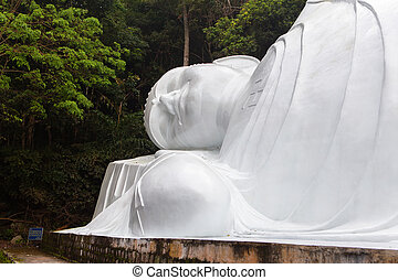 Lying Buddah statue in Ta Cu mountain, Vietnam. - Lying...
