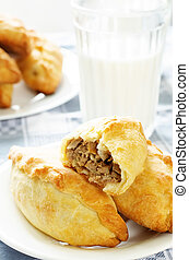 pasties stuffed meat on a light background. tinting....