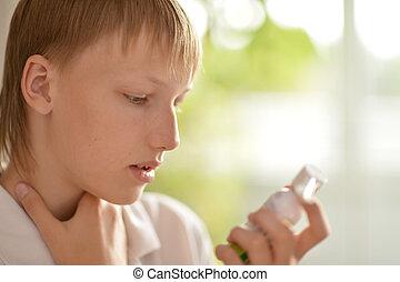 Teenage boy with inhaler