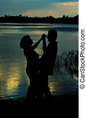 Happy Mature couple dance at twilight near river