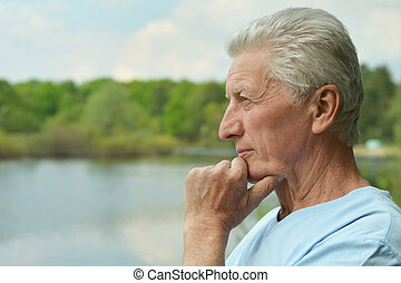 smiling elderly man - Portrait of smiling elderly man near...