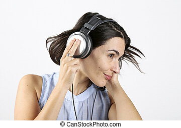 Woman feeling good listening to music with headphones and...