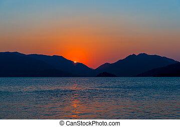beautiful seascape. sunrise over the calm sea