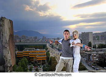 romantic urban couple dancing on top of bulding - romantic...