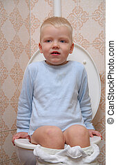 child on toilet