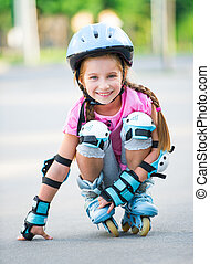 Girl on roller skates - Little girl on roller skates at park