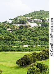 Condos Over Tropical Golf Course