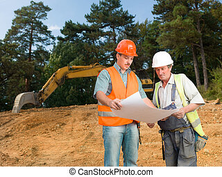 colleagues on construction site - front view of manager and...