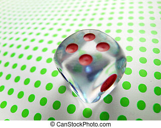 gambling dice on green dotted background
