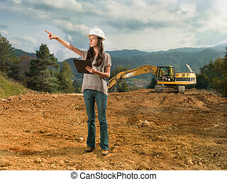 female engineer checking construction - portrait of young...