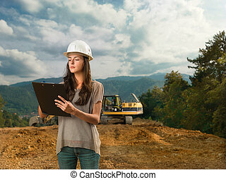 female inspector analizing construction - portrait of young...