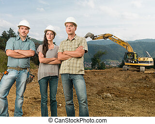 team of architects on construction site