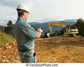 male engineer on construction site - side view of male...