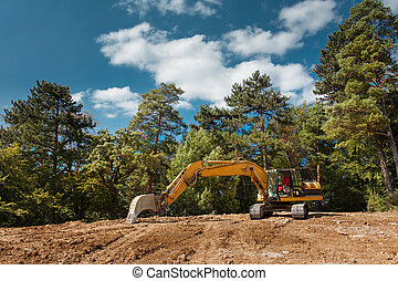 side view of excavator on construction site - side view of...