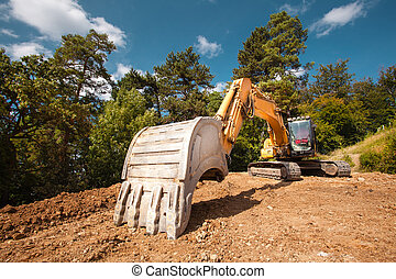 excavator on construction site - perspective view of...