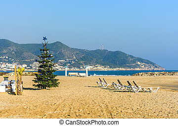 Christmas tree on sand beach in Sitges, Spain