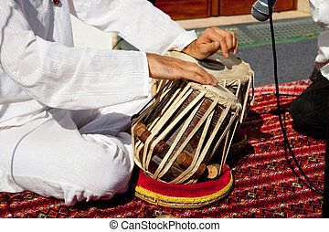 Traditional indian tabla drums - Man playing on traditional...