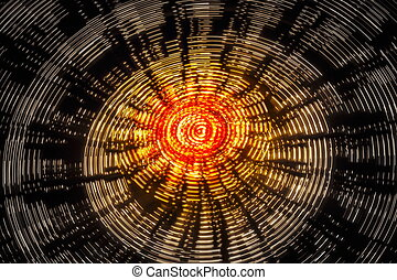 Rotating ferris wheel motion blur - Night long exposure of a...