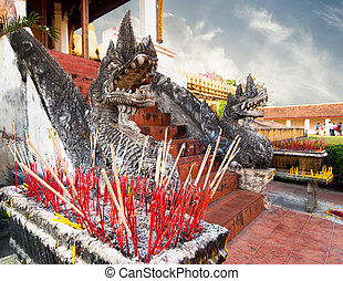 Aroma sticks at Phra That Luang Temple. Vientiane, Laos travel l