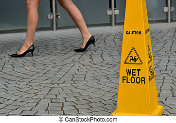 Slippery floor surface warning sign and symbol in building,...