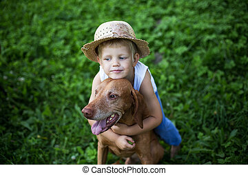Child love his dog - Outdoor portrait: Child love his...