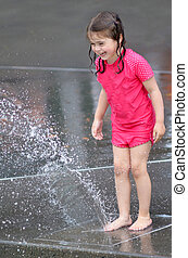 Child play water with water fountain - Child (girl age 04)...