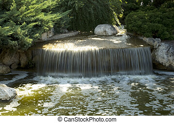 Waterfall in the park. Monaco. - Waterfall in the national...