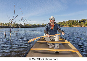 paddling canoe on a lake