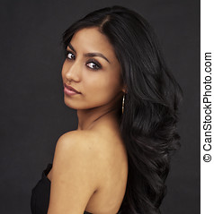 Beautiful young woman with dark long hair