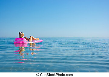 Blonde girl on inflatable raft