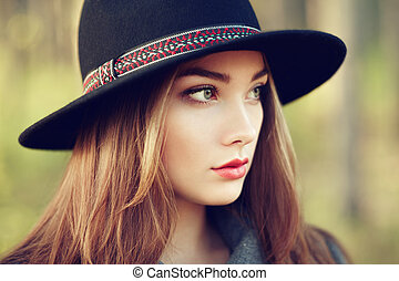 Portrait of young beautiful woman in autumn coat Girl in hat...