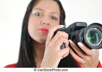 Young woman holding camera in hand taking picture isolated