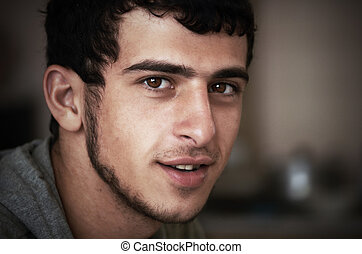 young a swarthy guy - close-up portrait of a young a swarthy...