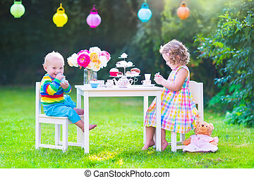 Children at doll tea party - Two happy children, cute curly...