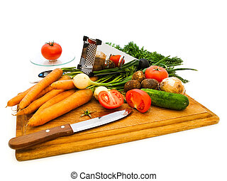 vegetables - Various vegetables and knife on a kitchen board...