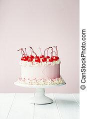 Cake decorated with maraschino cherries - Cake decorated...