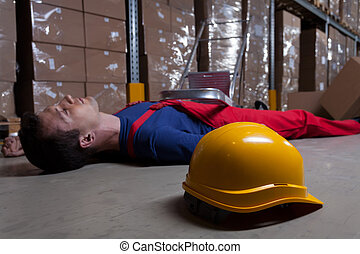 Man on the floor in factory - Man on the floor in a factory