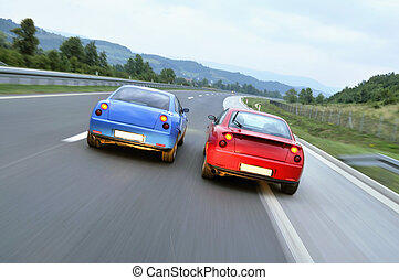 Tuning cars racing down the highway - Two hot tuning cars...
