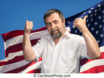Thumbs up sign against USA flag