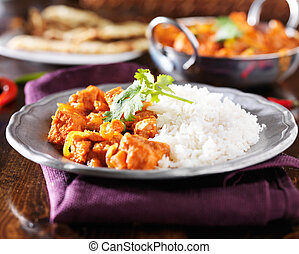 indian chicken vindaloo curry with basmati rice on plate
